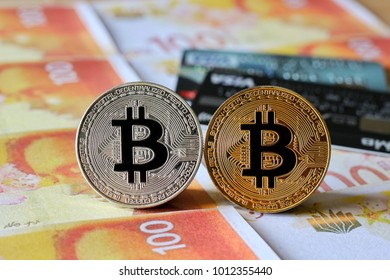 Bitcoin on Israel Shekel Banknotes Background with credit cards