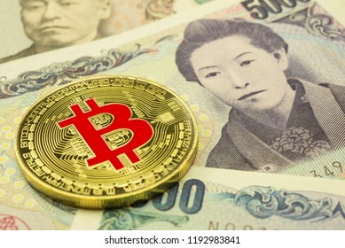 Bitcoin on Japanese yen banknotes. Concept of blockchain technology, digital money, e-wallet. Bitcoin is cryptocurrency form of electronic cash. Japan Is the friendliest cryptocurrency country in asia