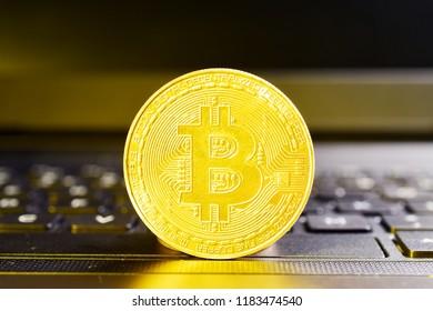 bitcoin on laptop, close up.