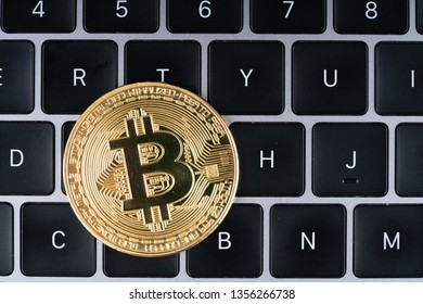 Bitcoin on the laptop keyboard