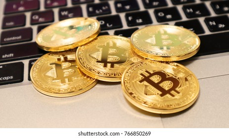 Bitcoin on Laptop Keyboard. Concept for Mining Cryptocurrencies.