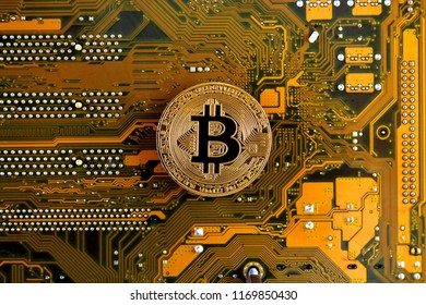 Bitcoin on a Motherboard Technology. Hi-tech concept background.