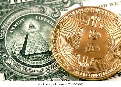 bitcoin on one dollar close up