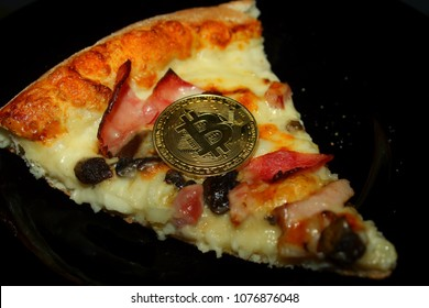 Bitcoin on a piece of pizza.