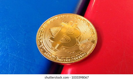Bitcoin on red and blue background