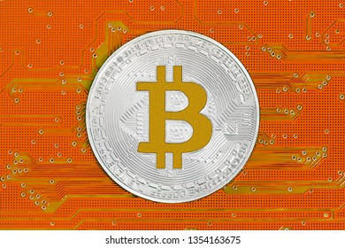 Bitcoin on red circuit board. Bitcoin cryptocurrency on computer electronic circuit board. Cybercrime background