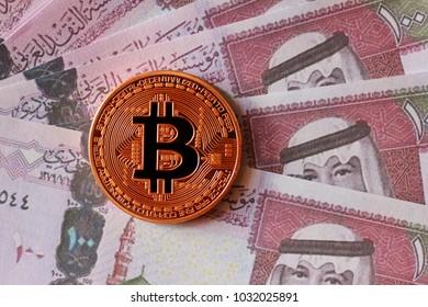 Bitcoin on Saudi Arabian Riyal Banknotes Background