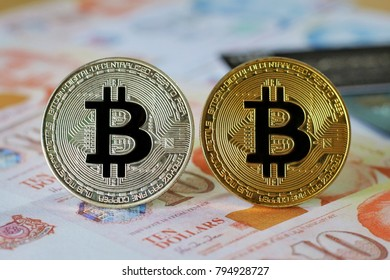 Bitcoin on Singapore Dollars Banknotes background with credit cards