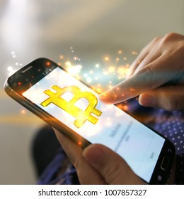 bitcoin on smartphone screen for online payment . digital currency, e-Money, Financial Internet Technology Concept.