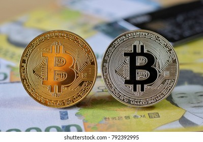 Bitcoin on South Korea Won Banknotes background with credit cards