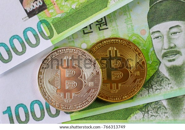 Bitcoin on South Korea Won Banknote background