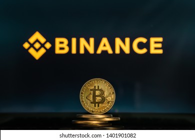 Bitcoin on a stack of coins with Binance logo on a computer screen. SLOVENIA, LJUBLJANA - 02.24.2019