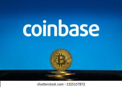 Bitcoin on a stack of coins with Coinbase logo on a laptop screen. Cryptocurrency and blockchain adoption getting mainstream. Slovenia - 02 24 2019