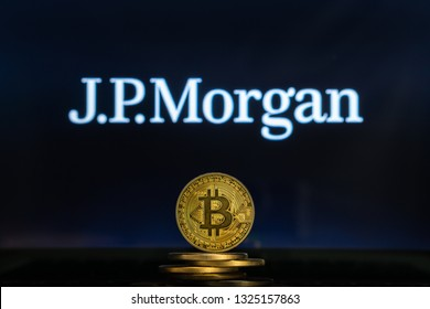 Bitcoin on a stack of coins with JPMorgan logo on a laptop screen. Cryptocurrency and blockchain adoption getting mainstream. Slovenia - 02 24 2019