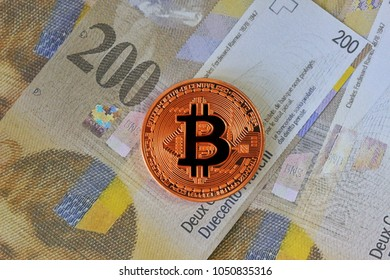Bitcoin on Swiss Franc Banknotes Background , Cryptocurrency concept