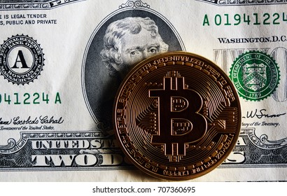 Bitcoin on two dollar banknote. Trading concept .