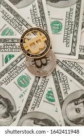 Bitcoin on US dollar bills. Electronic money exchange concept.