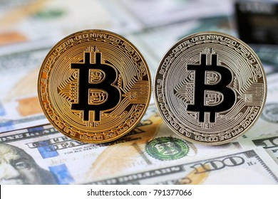 Bitcoin on Us Dollars Banknotes background with credit cards