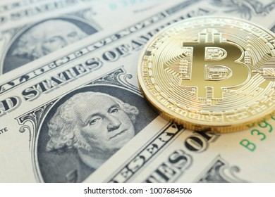Bitcoin on US Dollars Bill, Concept for Cryptocurrency