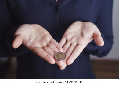 Bitcoin on the woman's palms