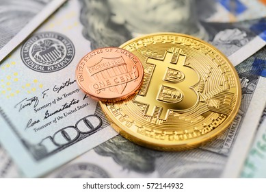 Bitcoin and one cent coin on US dollar bills, macro shot