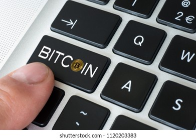 Bitcoin in one of the keys of the keyboard of a computer