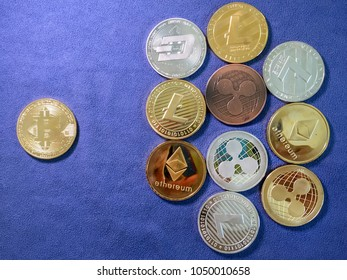Bitcoin and others crypto coin on blue cloth. Virtual cryptocurrency concept.
