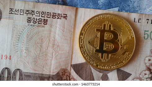 Bitcoin over Kim Il Sung's face on a banknote
