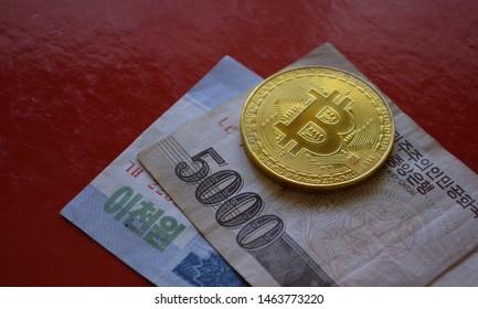 Bitcoin over North Korean won bank notes