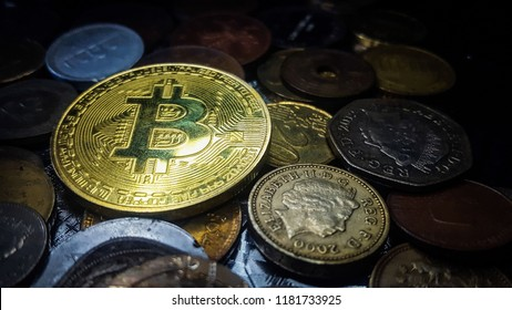 Bitcoin. Physical bit coin. Digital currency. Cryptocurrency. Golden coin with bitcoin symbol.