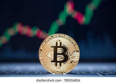 Bitcoin physical coin symbol on laptop with uptrend price graph background, future concept financial currency, crypto currency sign