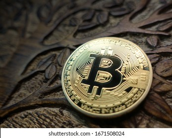 Bitcoin physical representation on a hand carved exotic wood piece