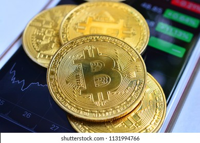 bitcoin pile on smartphone for concept investment fund finance and digital money cryptography block chain