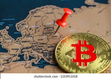 Bitcoin and pushpin on Belarus part of map. Investment in/ mining of bitcoin in Belarus concept.