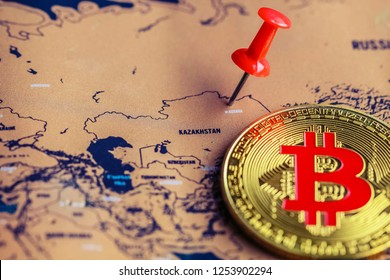 Bitcoin and pushpin on Kazakhstan part of world map. Operations with bitcoin in Kazakhstan concept.