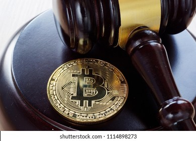 Bitcoin Regulation. BTC crypto coin and gavel on a desk.