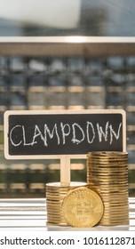 Bitcoin replica with clampdown text on mini chalkboard