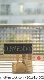 Bitcoin replica with clampdown text on mini chalkboard and Japanese flag