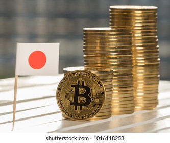 Bitcoin replica with mini Japan flag on table top
