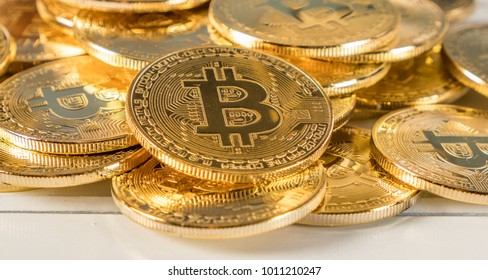 Bitcoin replica over white wooden tabletop background