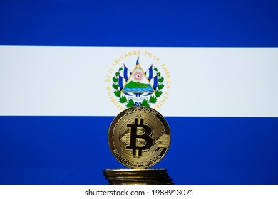 Bitcoin representation coin placed in front of blurred Salvador's national flag. El Salvador is the first country to adopt bitcoin as legal tender. Concept. - Shutterstock ID 1988913071