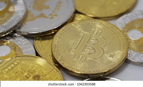 Bitcoin and ripple cryptocurrencies on white background
