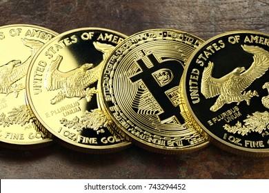 Bitcoin in a row of 1 ounce American gold eagle bullion coins