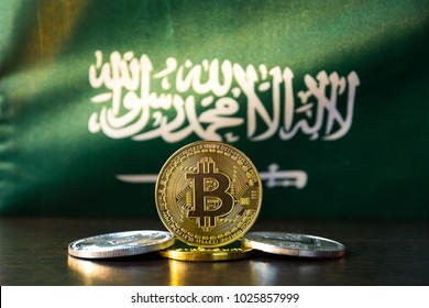 Bitcoin and Saudi Arabia Flag. Concept for investors in cryptocurrency and Blockchain Technology in Saudi Arabia.