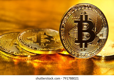 Bitcoin. several coins of bitcoin on a golden background