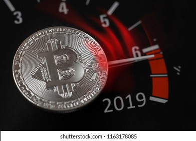 Bitcoin. Speedometer of bitcoin with a red arrow, cryptocurrency concept. 2019