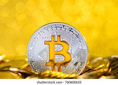 Bitcoin stand in pile on golden coins