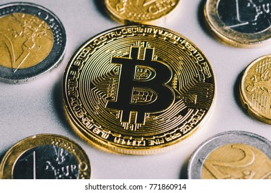 Bitcoin styled coin with international currency banknotes and Euro money