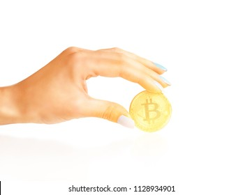 Bitcoin - symbol of crypto currency in a female hand on a white background.