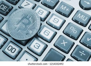 Bitcoin symbol on calculator background, count bitcon price concept